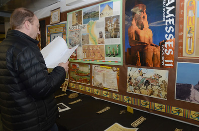 Erica Benson—ebenson@shawmedia.com  Patrick Sapinski reads his daughter's story during the Neil Armstrong mastaba exhibit hosted by 5th graders of Avery Coonley School Thursday Feb. 21 2013.