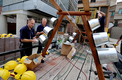 Kirk Stotz, left, Ryan Thorpe and Brian Hunter, work on the Avista entry for the parade on Monday. Avista Adventist Hospital is again pulling out all the stops in creating their float for the Louisville Labor Day Parade. For a video and photos of the float, go to www.dailycamera.com. Cliff Grassmick / September 1, 2011