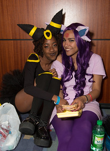 Aprill as Umbreon Courtney as Espeon take a lunch break