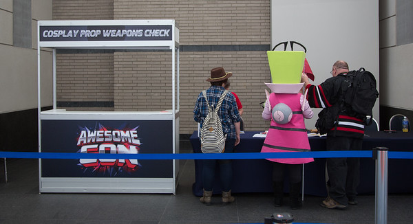 "Costumed attendees had to check and flag their ""weapons"" before entering the event. Ray guns, spears and swords were given colored tags."
