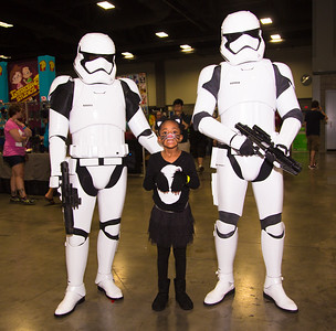 Nariah (age 6) poses with Imperial Stormtroopers
