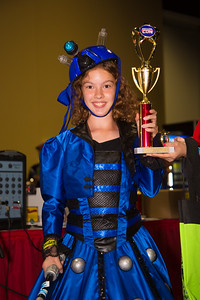 Gwen Abrams (age 10) as Blue Dalek holds trophy from costume contest