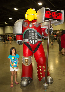Chloe as Slave Leia,  Abington, Md (left) with Brandon Williams of Sanguinary Cosplay as Warhammer 40k Space Marine