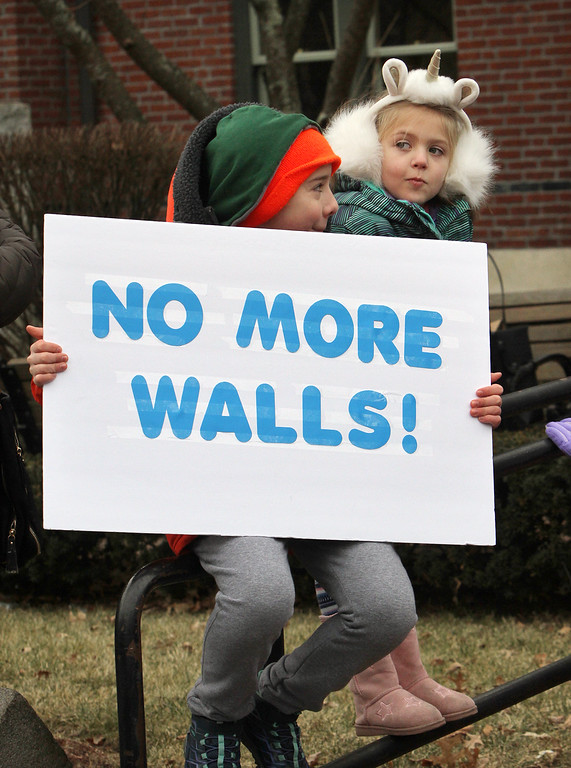 . Women\'s March in Ayer begins with a rally at Town Hall. Relic Reilly, 12, of Townsend, and his cousin Caitlin McMullin, 5, of Marlboro. (SUN/Julia Malakie)