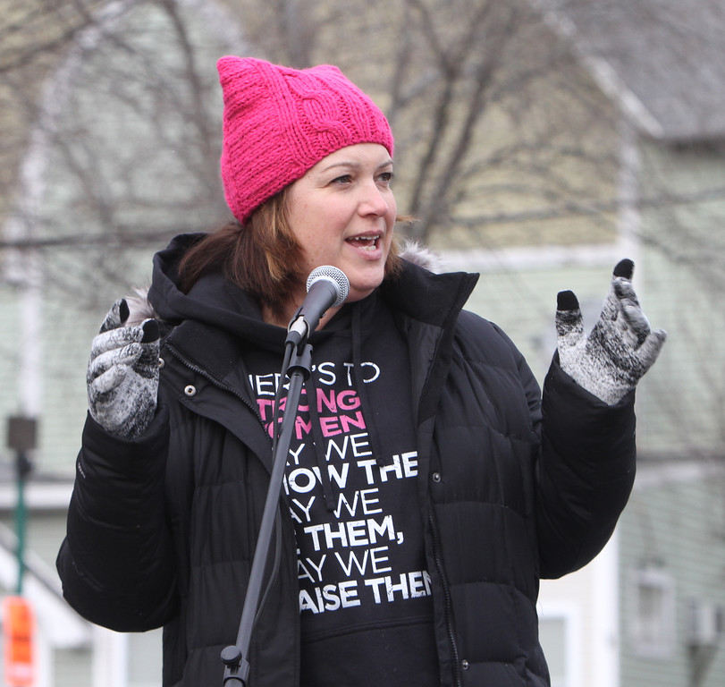 . State Rep. Jennifer Benson (D-Lunenberg) speaks as Women\'s March in Ayer begins with a rally at Town Hall. (SUN/Julia Malakie)