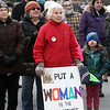 Women's March in Ayer begins with a rally at Town Hall. Vera Spohr of Littleton, center with sign. (SUN/Julia Malakie)
