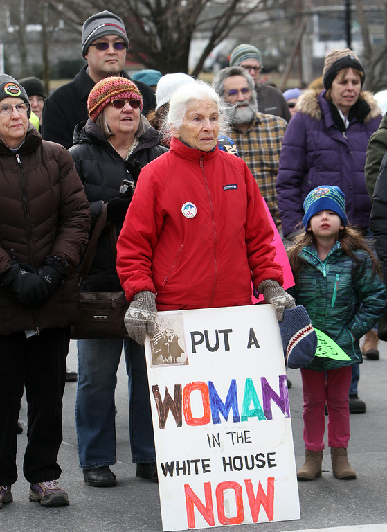. Women\'s March in Ayer begins with a rally at Town Hall. Vera Spohr of Littleton, center with sign. (SUN/Julia Malakie)