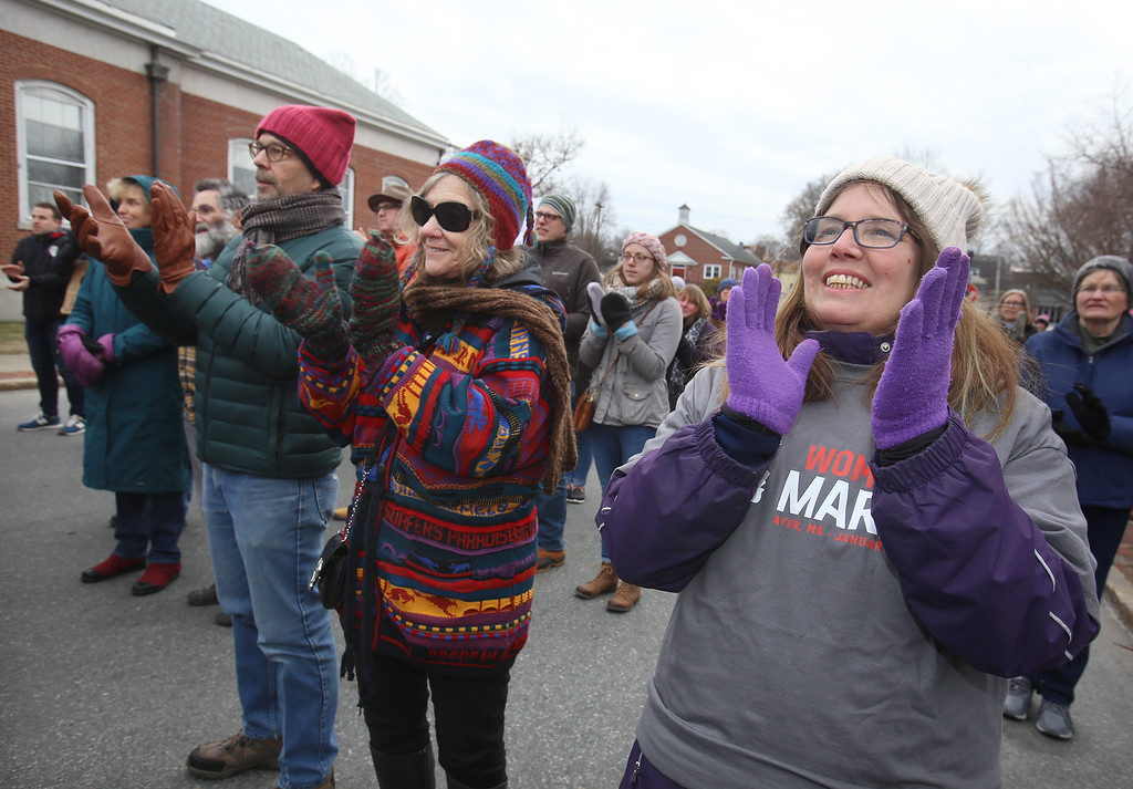 . Women\'s March in Ayer begins with a rally at Town Hall. From left front, James Nehring of Ayer, Diana Suskind of Leominster, Beth Condon of Ayer. (SUN/Julia Malakie)