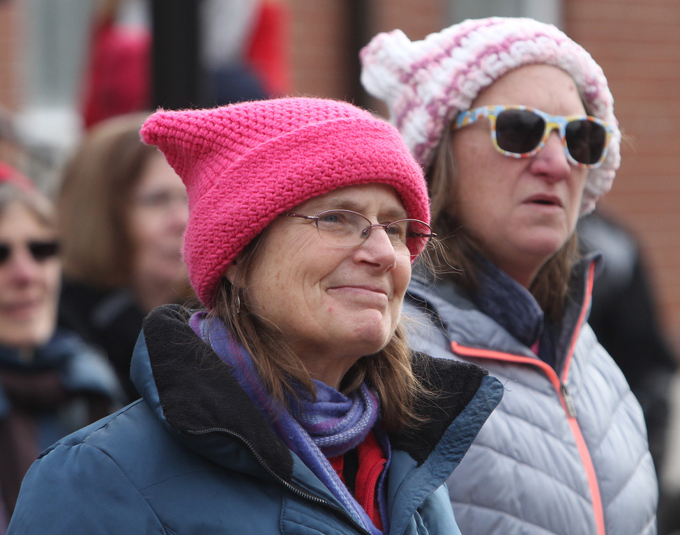 . Women\'s March in Ayer begins with a rally at Town Hall. Laurie Nehring of Ayer, left, and Amy Gust of Westford. [no relation] (SUN/Julia Malakie)