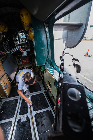 The left waist gunner.  One of the crew was drying the bare aluminum; it was just got done raining and people walked in with their wet shoes, me included.