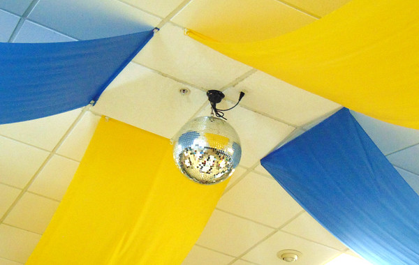 Debbie Blank | The Herald-Tribune<br /> The ceiling was festooned with fabric in the state's bicentennial colors -- blue and yellow -- and even a disco ball!