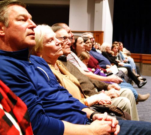 Debbie Blank | The Herald-Tribune<br /> The front row of spectators listen as superintendent Paul Ketcham speaks during the auditorium dedication.