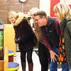 """In the activity lab, Michelle Werner (from left), Dale Dickey, son Brad Dickey and library board Vice President Anne Amrhein marvel at the terrarium. Werner, a longtime friend of children's services coordinator Sandy Dickey, said, """"I know she's been working very, very hard on this."""""""
