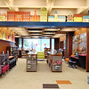 """An archway beckons kids into their fresh area at the Batesville Memorial Public Library. Board President Mark Stenger says, """"We tried to put in as much local history and cityscapes as we could, so when kids come in, it looks familiar."""" An open house was held Nov. 16."""