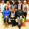 Testing out a new lime green couch, the staff celebrates the completion of another updated space at the library. They are (front row from left) circulation specialist Jean Werner, BMPL director Kim Porter, children's services coordinator Sandy Dickey; (back row) technical services supervisor Judi Craig, business administrator Candy Bessler, genealogy and home-schoolers coordinator Denean Williams, children's assistant Tessa Gutzwiller and library clerk Karen Oesterling.