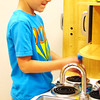 Zach Marcy, 5, Batesville, sharpens his kitchen skills in a play area.