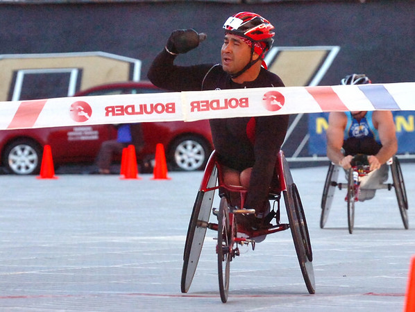 BOLDER<br /> Saul Mendoza celebrates his 12th win in the wheelchair division <br /> during the 32nd Annual Day Bolder Boulder on Monday.<br /> Photo by Marty Caivano/Camera/May 31, 2010