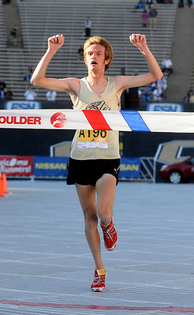BOLDER<br /> Men's citizen winner Brian Medigovich crosses the finish line during the 32nd Annual Day Bolder Boulder on Monday.<br /> Photo by Marty Caivano/Camera/May 31, 2010
