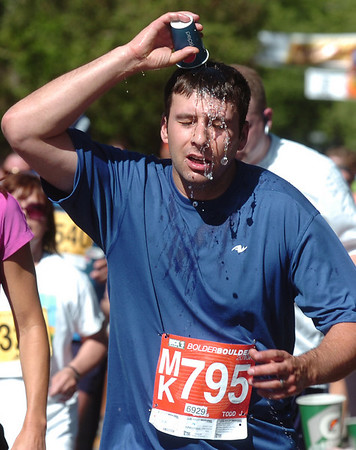 Todd Belanger cools off during the Bolder Boulder on Monday May 31, 2010<br /> Photo by Paul Aiken / The Camera / May 31, 2010