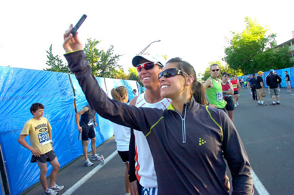 Lauren Rinck takes a self portrait with Brandon Barnett before the start of the Bolder Boulder on Monday May 31, 2010<br /> Photo by Paul Aiken / The Camera / May 31, 2010