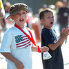 Jackson Walton, 9, at left and his brother Josh, 7, cheer on the runners during the Bolder Boulder on Monday May 31, 2010<br /> Photo by Paul Aiken / The Camera / May 31, 2010