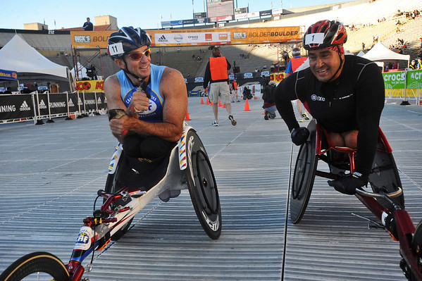 BOLDER<br /> Wheelchair winner Saul Mendoza, rights, talks with second place finisher Scott Parsons at the finish line during the 32nd Annual Day Bolder Boulder on Monday.<br /> Photo by Marty Caivano/Camera/May 31, 2010