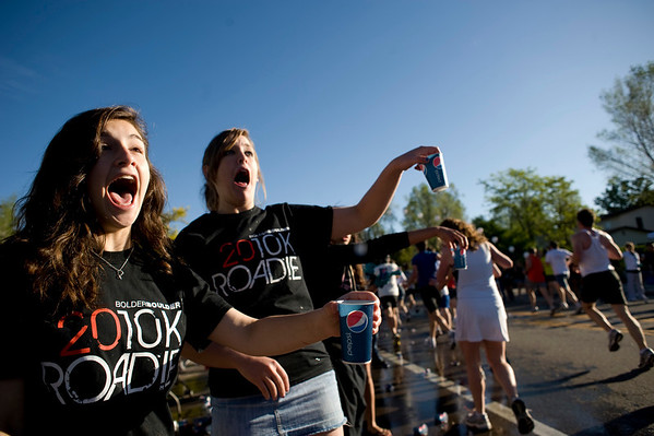 """Boulder High School cheerleaders Becky Levine, 15, (left) and Kendall Hudson, 16, hand out water cups to runners during the annual Bolder Boulder 10K Road Race in Boulder, Colorado, Monday, May 31, 2010. <br /> <br /> Kasia Broussalian<br /> <br /> For a video, please visit  <a href=""""http://www.dailycamera.com"""">http://www.dailycamera.com</a>"""