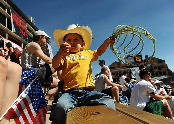 BOLDER<br /> Noah Harris, 3, of Grand Junction, plays with his lariat while waiting for other family members to finish running the 32nd Annual Day Bolder Boulder on Monday.<br /> Photo by Marty Caivano/Camera/May 31, 2010