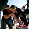 "Kiera Schuler does a keg stand while watching runners pass during the annual Bolder Boulder 10K Road Race in Boulder, Colorado, Monday, May 31, 2010. <br /> <br /> Kasia Broussalian<br /> <br /> For a video, please visit  <a href=""http://www.dailycamera.com"">http://www.dailycamera.com</a>"