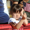 BOLDER<br /> Maya Smith, 4, of Lafayette, waves her flag while watching runners enter Folsom Field during the 32nd Annual Day Bolder Boulder on Monday.<br /> Photo by Marty Caivano/Camera/May 31, 2010