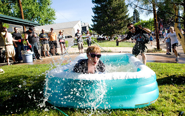 """Rick Poppe jumps into a baby pool during the annual Bolder Boulder 10K Road Race in Boulder, Colorado, Monday, May 31, 2010. <br /> <br /> Kasia Broussalian<br /> <br /> For a video, please visit  <a href=""""http://www.dailycamera.com"""">http://www.dailycamera.com</a>"""