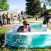 "Rick Poppe jumps into a baby pool during the annual Bolder Boulder 10K Road Race in Boulder, Colorado, Monday, May 31, 2010. <br /> <br /> Kasia Broussalian<br /> <br /> For a video, please visit  <a href=""http://www.dailycamera.com"">http://www.dailycamera.com</a>"