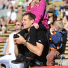 BOLDER<br /> Austin Dahl of Golden, holding his daughter Analie, 7, and son Arissen, 3, watches for his wife and other son during the 32nd Annual Day Bolder Boulder on Monday. <br /> Photo by Marty Caivano/Camera/May 31, 2010