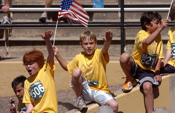 BOLDER<br /> Left to right, Jason Fether, Donovan Nolan and Max Dooley cheer on other runners after completing their own race during the 32nd Annual Day Bolder Boulder on Monday.<br /> Photo by Marty Caivano/Camera/May 31, 2010