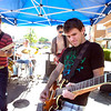 Jason Potter, left and Chris Treiling of Greg Knows and the Generators play for the runners on Folsom Street at the Bolder Boulder on Monday May 31, 2010<br /> Photo by Paul Aiken / The Camera / May 31, 2010