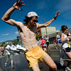 "Dustin Simerns jumps through a sprinkler on Pearl Street during the annual Bolder Boulder 10K Road Race in Boulder, Colorado, Monday, May 31, 2010. <br /> <br /> Kasia Broussalian<br /> <br /> For a video, please visit  <a href=""http://www.dailycamera.com"">http://www.dailycamera.com</a>"
