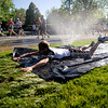 "Scott Stiehr runs through a ""slip-n-slide"" during the annual Bolder Boulder 10K Road Race in Boulder, Colorado, Monday, May 31, 2010. <br /> <br /> Kasia Broussalian<br /> <br /> For a video, please visit  <a href=""http://www.dailycamera.com"">http://www.dailycamera.com</a>"
