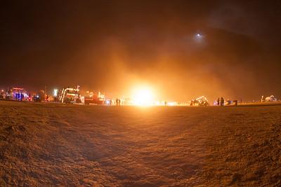 Playa at night lit up by random fire