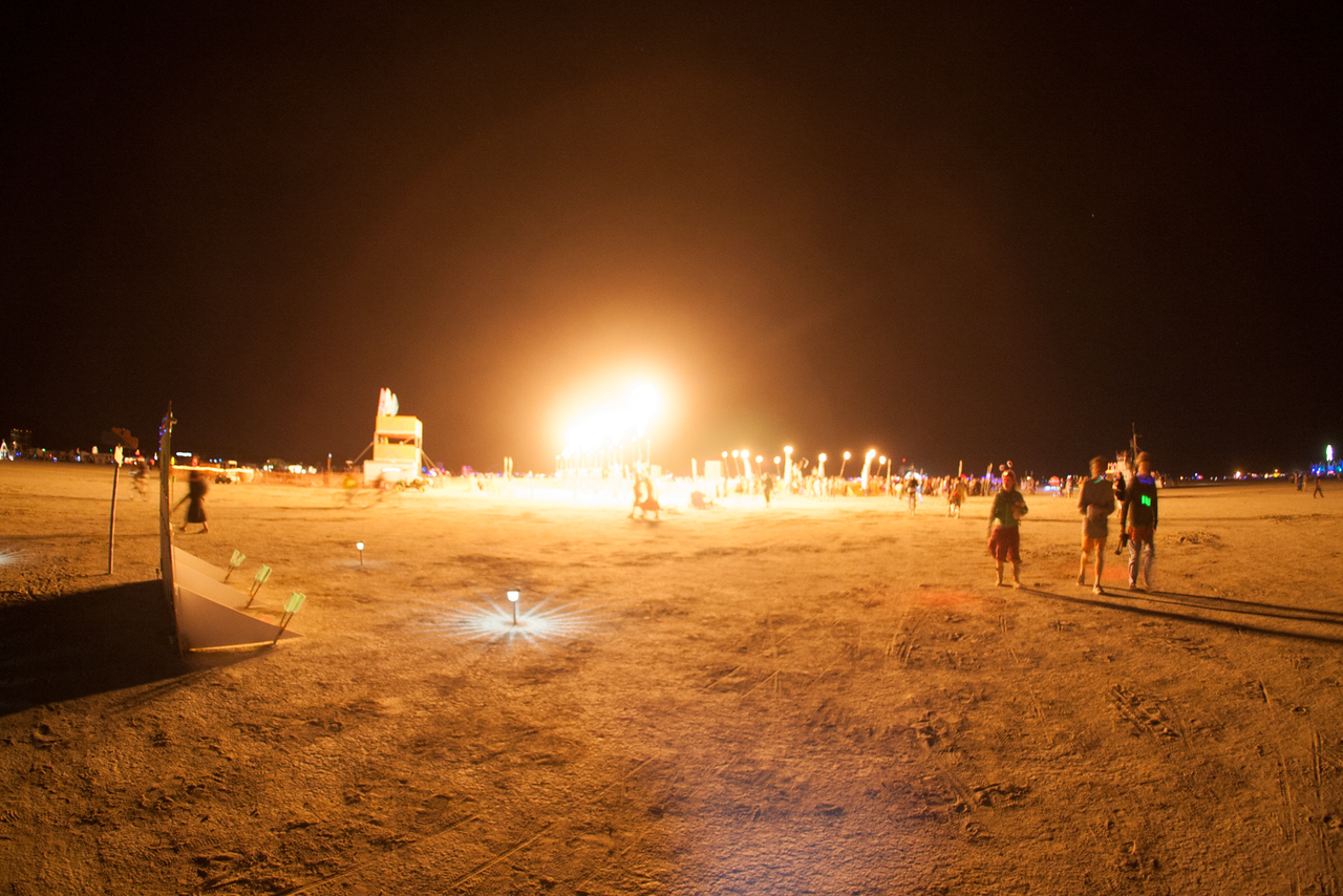 Random fire lighting up the playa at night.