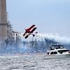 BI-PLANE stunt over beach at Huntington Beach Power Plant.