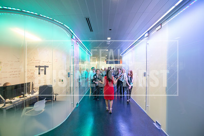 Expats and guests take a tour of the Gates Vascular Institute.