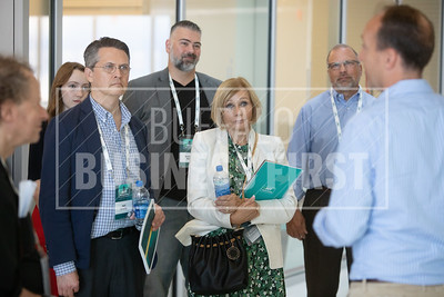 Buffalo expats Will Crosby, Brandon Betts, Deborah McLaughlin, and Steve Verney listen to Matthew Enstice, president, Buffalo Niagara Medical Campus, during their tour of the campus.