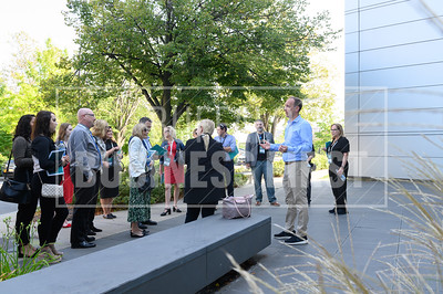 Buffalo expats listen to Matthew Enstice, president, Buffalo Niagara Medical Campus, during a stop at the Hauptman-Woodward Medical Research Institute.