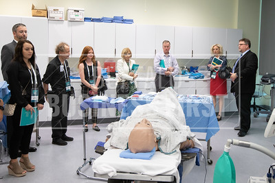 Expats and guests take a tour of the Jacobs Medical School