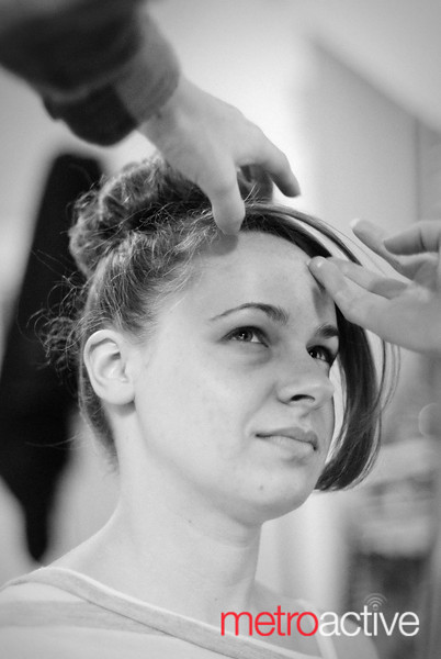 Local designer Christina Keelan does model Karen Donohue's hair before a fashion & music show to benefit the Bill Wilson Center.<br /> <br /> Photo by Jessica Shirley-Donnelly, JRSD Photography