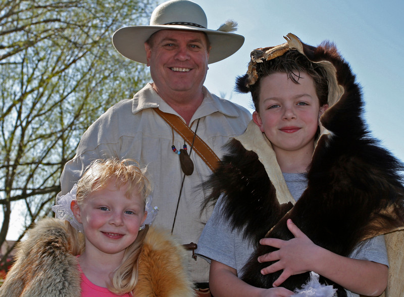 David, one of our brave Mountain Men, poses with two visitors.