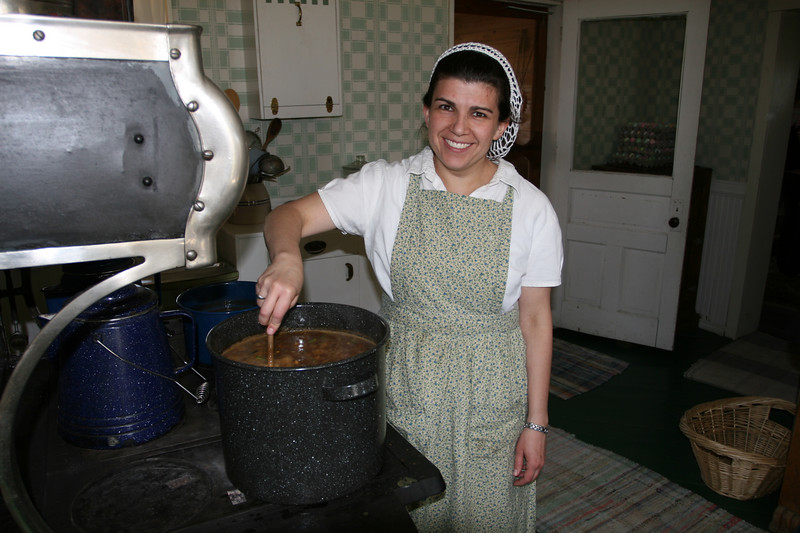 Marie cooks up a fine soup in the 1917 farmhouse.