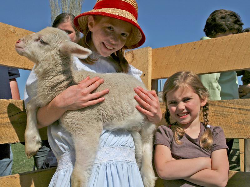 Liza, a visitor, enjoyed seeing this lamb up close.