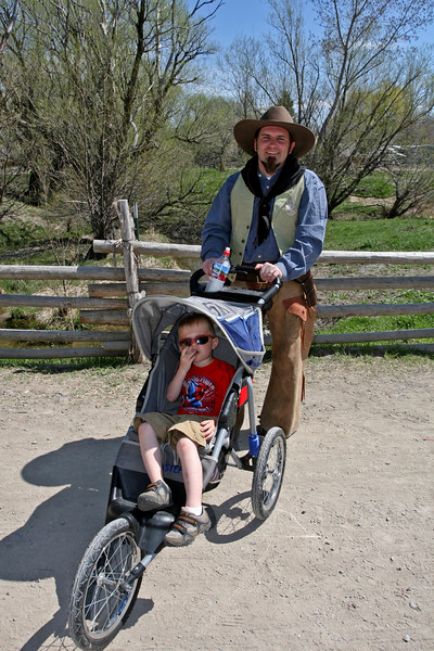 This is strange, an old Pony Express guy with a modern baby carriage!