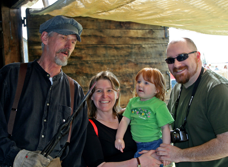 """Mike, one of our blacksmiths, shows a family what it means to be """"hot""""."""
